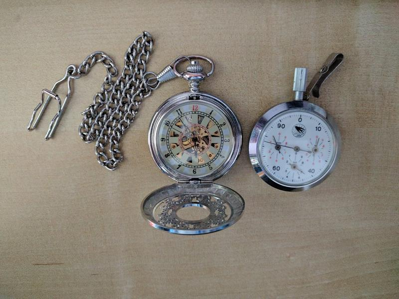 Left: Wind up pocket watch, Right: Mechanical pedometer