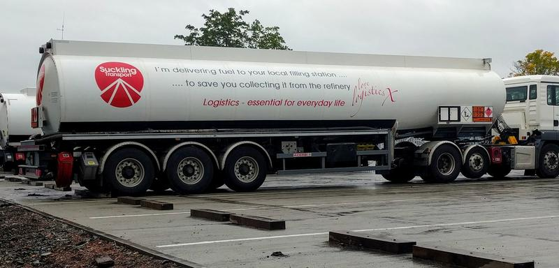 A white fuel tanker with gray text on the side.