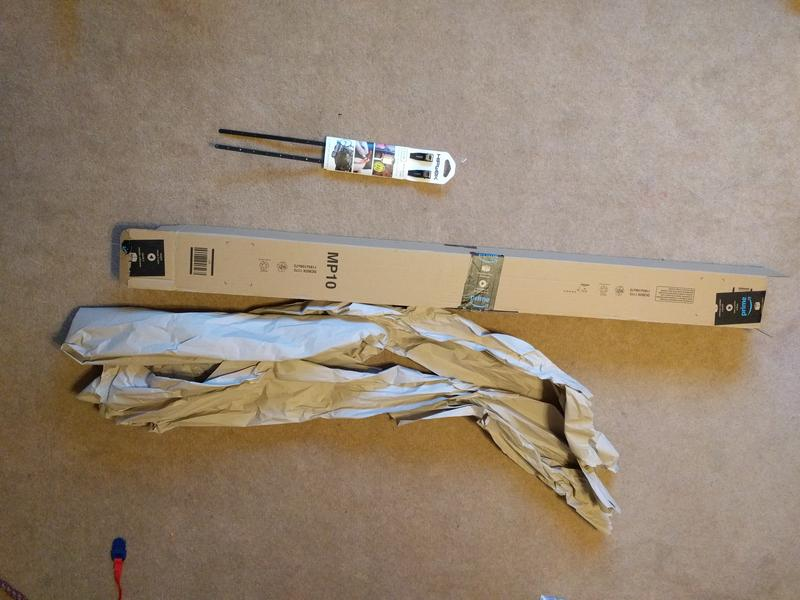 Small pacet of two cable ties next to very long cardboard box